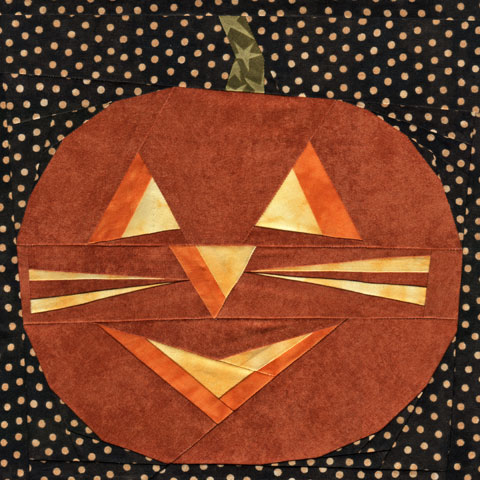 A Halloween Cat Face Curved Jack-O-Lantern Quilt Pattern