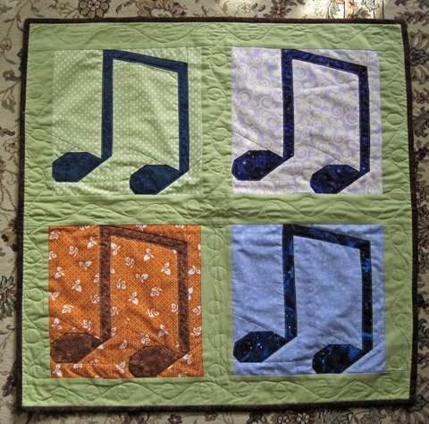 Four Seasons quilt with paper pieced Music Notes pattern